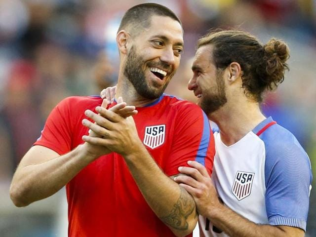 United States forward Clint Dempsey (left) celebrates with midfielder Graham Zusi (right) after the game.