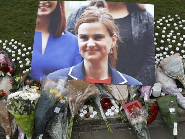 Tributes and candles left for murdered Labour Member of Parliament Jo Cox are seen in Parliament Square, London, Britain June 17, 2016 REUTERS/Stefan Wermuth