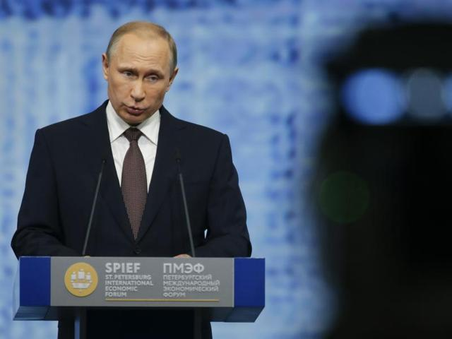 Russian President Vladimir Putin speaks at the St Petersburg International Economic Forum in Russia.