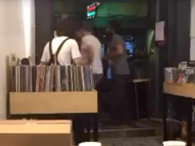 Images filmed during the altercation and widely circulating on social media show the attackers hurling barstools and wrecking the store.
