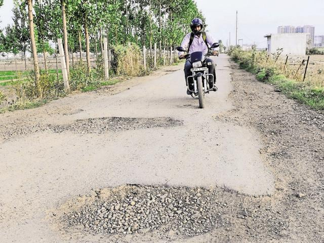 """""""Driving vehicles on the road is a challenge due to a number of pits, most of which are more than one foot deep,"""" said Ranjeet Singh, a resident of Kharar who uses the road to commute everyday for work."""