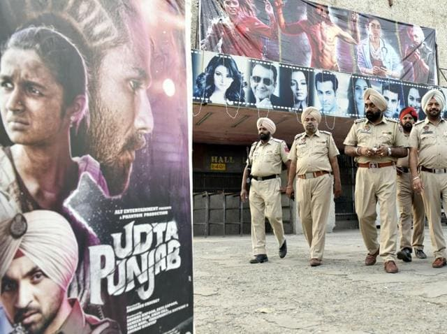 Policemen stand guard outside a cinema hall screening Bollywood movie Udta Punjab in Amritsar.