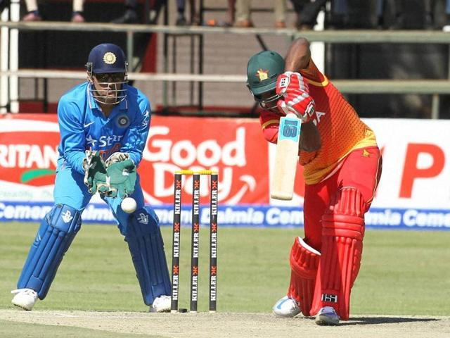 Zimbabwean batsman Vusimusi Sibanda, right, plays a shot next to Indian wicket keeper MS Dhoni.