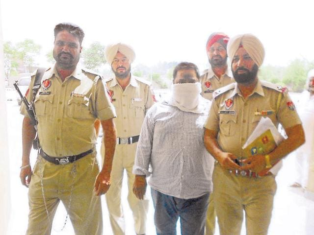 The accused in police custody in Batala on Friday.