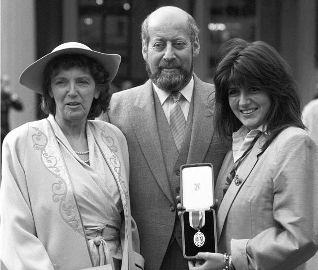 File photo of Clement Freud with his wife Jill, left, and daughter Emma after receiving his knighthood at Buckingham Palace, in London.