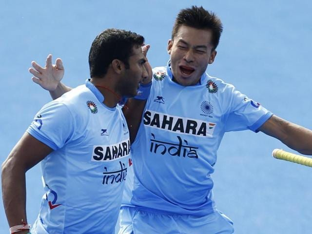 India's Raghunath Vokkaliga, left, celebrates scoring the first goal.