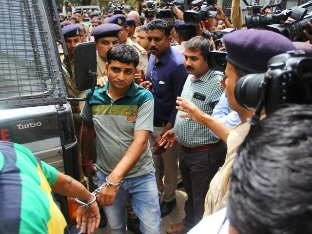 Convicts in the 2002 Gulberg Society massacre case arrive in a police vehicle for the pronouncement of their sentence on Friday, June 17, 2016.