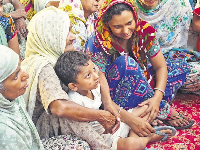 Mourning relatives of Gurdev Singh at Burj Jawahar Singh Wala village in Faridkot on Friday.