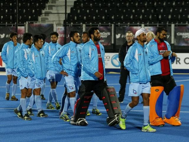 Indian players walk round the pitch after lodging a protest concerning the penalty shootout during the 1st and 2nd place match against Australia on day six of the FIH Men's Champions Trophy at the Queen Elizabeth Olympic Park.