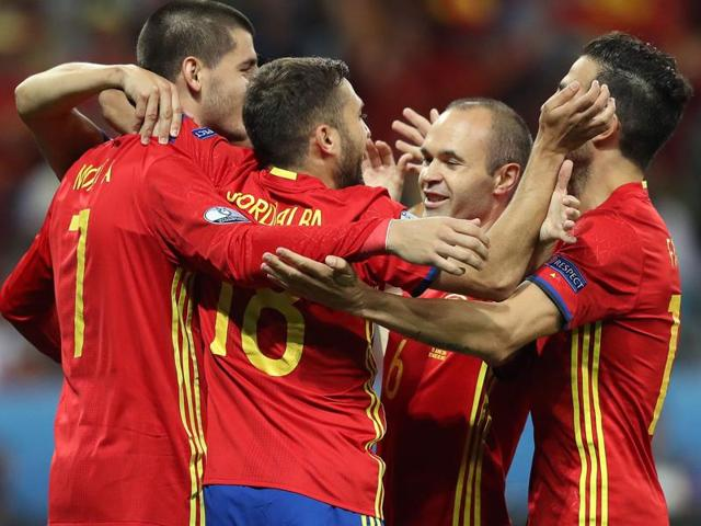 Spain's forward Alvaro Morata (L) is congratulated after scoring his second goal.