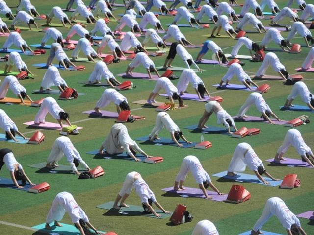 Indian women practice Yoga at a community park in a residential area as they prepare to participate in the International Yoga Day event in New Delhi.