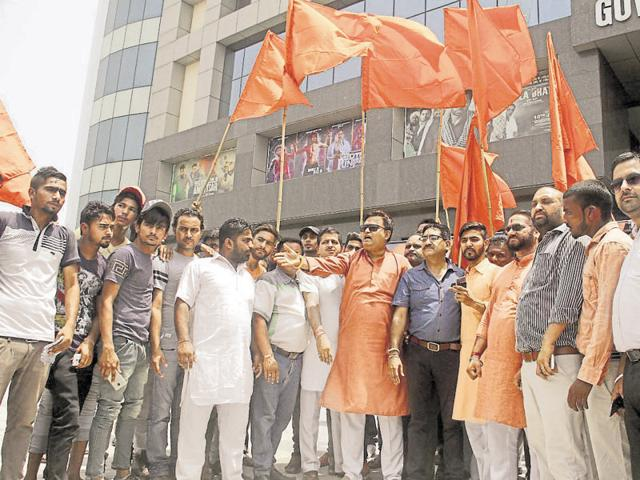 Members of Shiv Sena Punjab protest outside Govardhan Mall in Ludhiana on Friday.