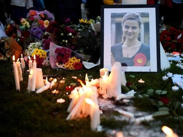 Candles are lit around floral tributes in Parliament Square central London in remembrance of Labour MP Jo Cox who was killed on a street in Birstall on June 16.