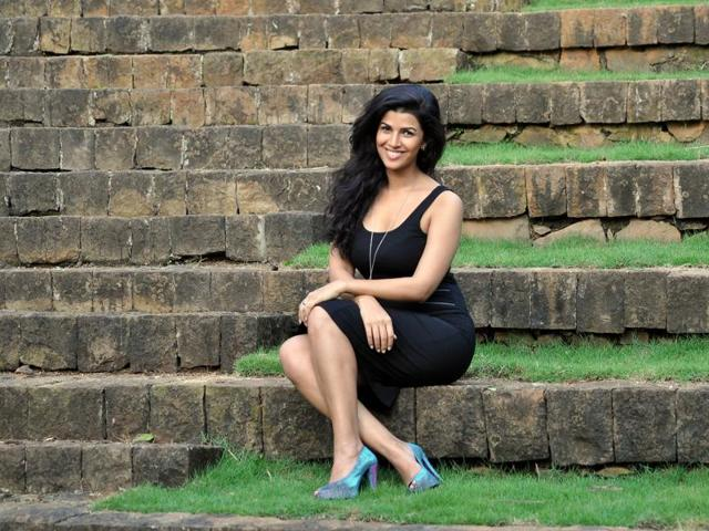 Actor Nimrat Kaur cannot stay indoors when she is not shooting and says she cannot sit still at one place.