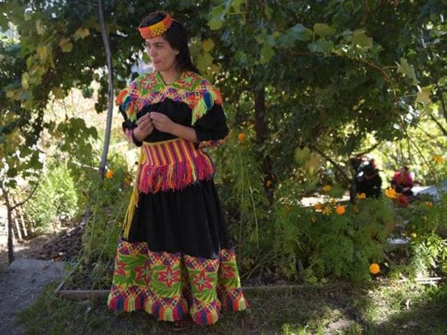 File photo of a Kalash girl  in Brun village of Bumburet Valley.