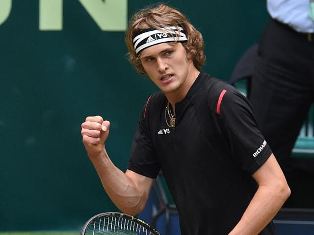 Zverev celebrates his victory against Federer, his first over a top-10 player.