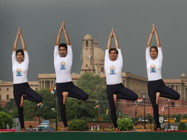 People practicing yoga at Rajpath on 1st International Day of Yoga.