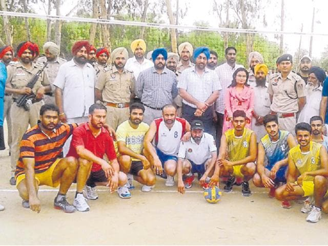 SSP Mukhwinder Singh with the teams before start of a volleyball match in Mansa.
