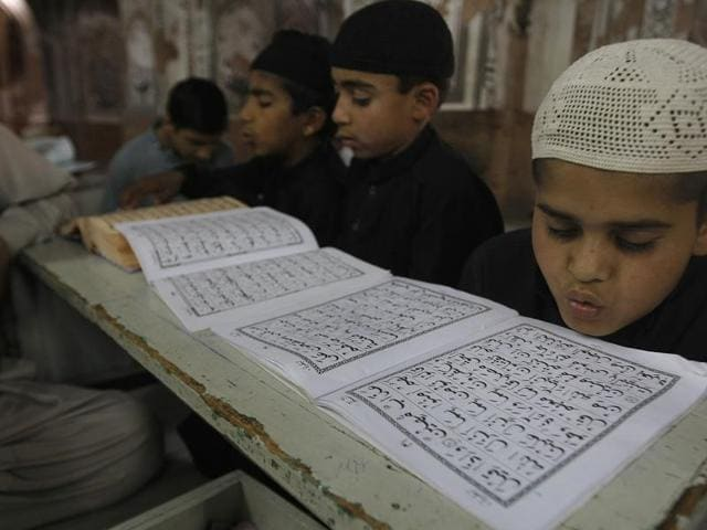 Students attend a madrassa in Peshawar. Religious schools in Pakistan, most of them in mosques are the only source of education for a number of children.