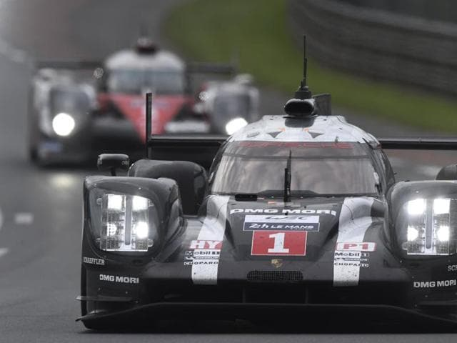 German's Timo Bernhard drives his Porsche 919 Hybrid N°1 ahead of Switzerland's Sebastien Buemi on his Toyota TSO50 – Hybrid N°5, during the 84th Le Mans 24-hours endurance race.
