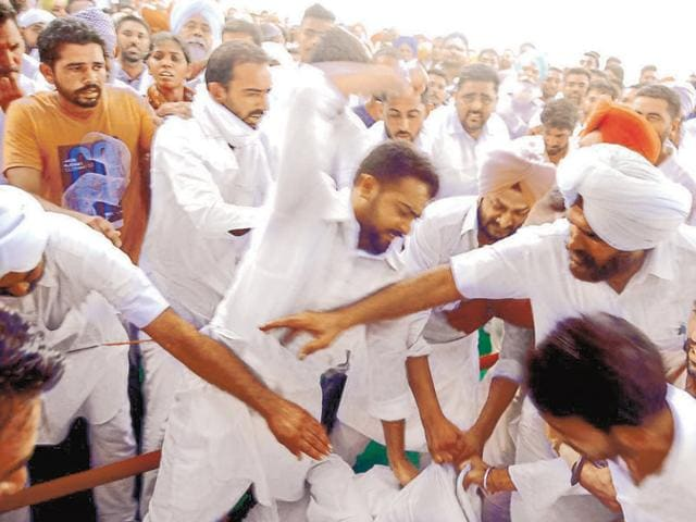 Congress workers coming to blows during a rally at Lambi village in Muktsar on Saturday.