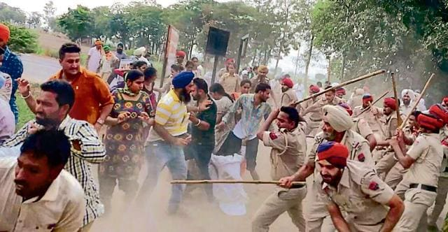 Police cane-charging protesting jobless elementary teachers at Jai Singh Wala village in Bathinda on Saturday.