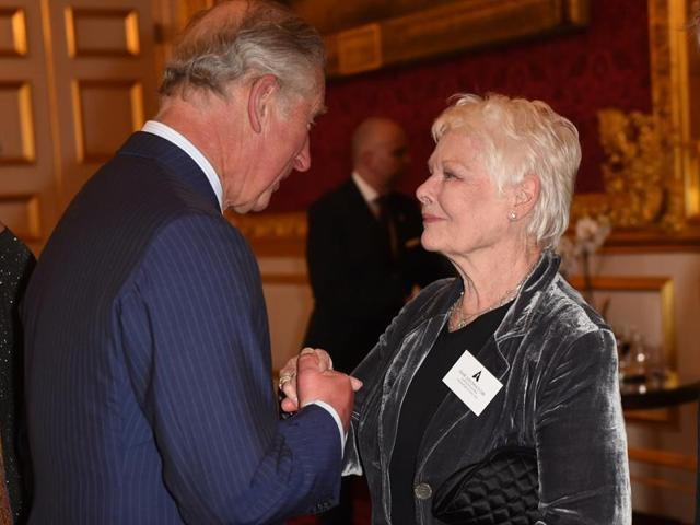 Britain's Prince Charles greets actor Judi Dench in  London. Dench will play Queen Victoria in a fim based on a book by Shrabani Basu.