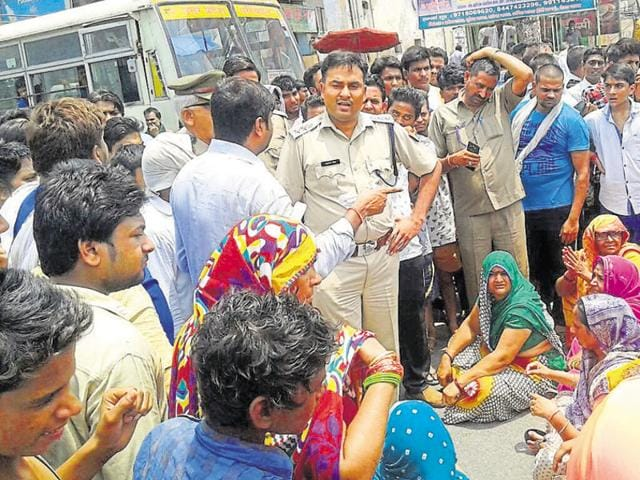 Residents, demanding arrest of the fugitive, held a protest in front of the Dadri police station and blocked the highway on Saturday.