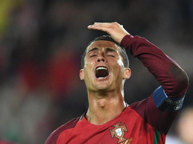 Portugal's forward Cristiano Ronaldo reacts after he missed to score a penalty during the Euro 2016 group F football match between Portugal and Austria at the Parc des Princes in Paris.