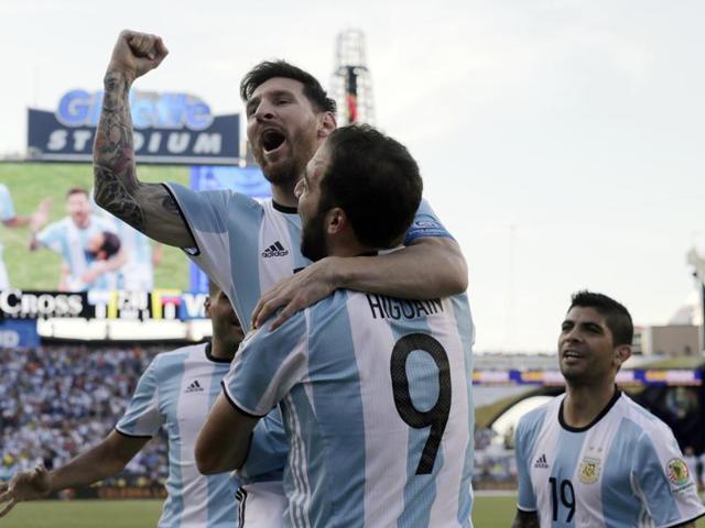 Lionel Messi celebrates a goal by Gonzalo Higuain (9) during the first half of a Copa America Centenario quarterfinal against Venezuela.