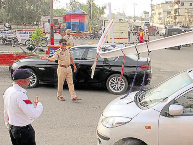 Barriers installed at Jagraon Bridge damaged on Saturday that resulted in a traffic jam in Ludhiana.