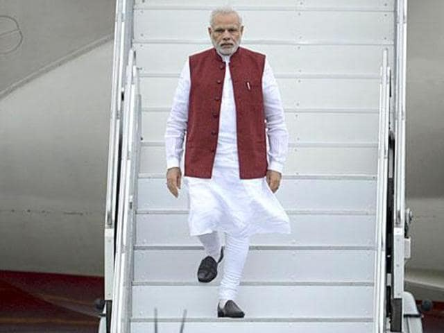 File photo of Prime Minister Narendra Modi disembarking a plane after a foreign trip.