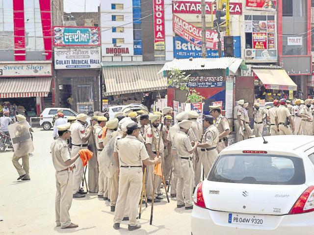 Cops keeping vigil at Kotkapura near Faridkot on Saturday.