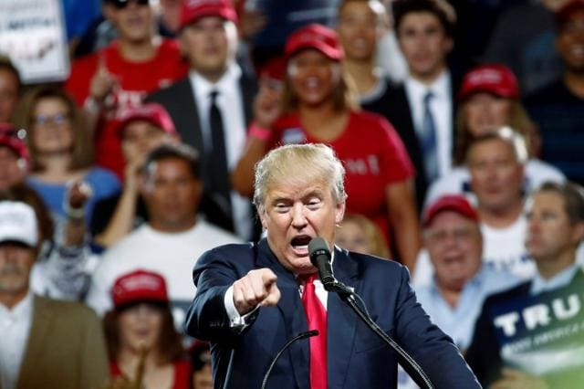 Republican US Presidential candidate Donald Trump speaks at a campaign rally in Phoenix, Arizona, June 18, 2016.