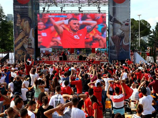 Albanian fans watch a live broadcast, showing Albania versus Switzerland in the European Championship in front of a big screen at Mother Teresa Square in the capital, Tirana.