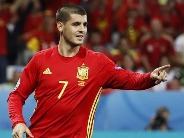 Spain's Alvaro Morata celebrates after scoring their third goal.