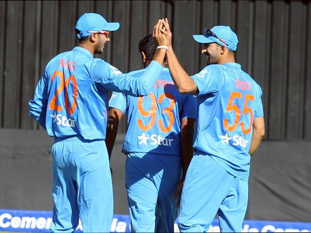 Indian players celebrate the wicket of Zimbabwe's captain Graeme Creamer, during the T20 International cricket match between Zimbabwe and India at Harare Sports Club.