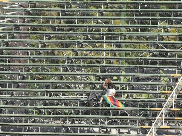 A lone Zimbabwean supporter sits in the stands during the One Day International cricket match against India at Harare Sports Club. The Indian cricket team is in Zimbabwe for One Day International and T20 matches.