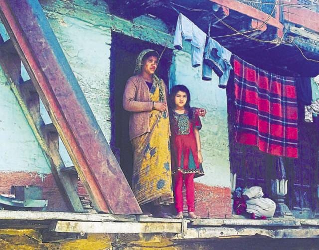 Sangeeta, who was widowed during the 2013 disaster, with her daughter at Rudraprayag's Devli Bhanigram village.