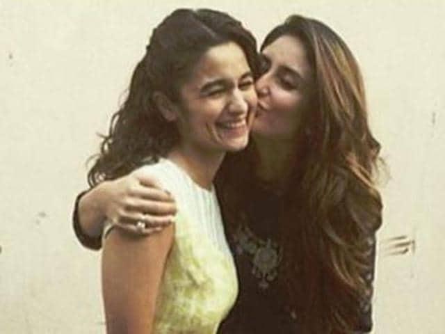 Kareena gives Alia a peck on her cheek during Udta Punjab promotions.