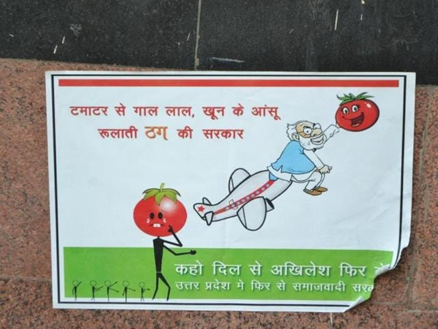 A poster targetting Prime Minister Narendra Modi is displayed on a wall in Agra city.