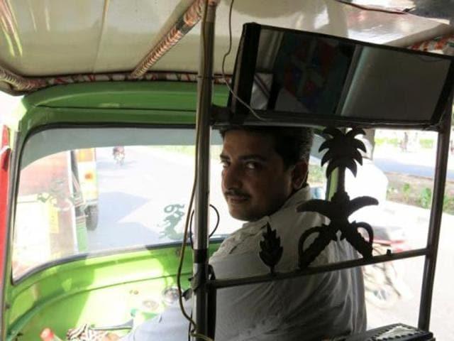 Rixi rickshaw driver Saeed Akhtar sits in his rickshaw in Lahore, Pakistan.