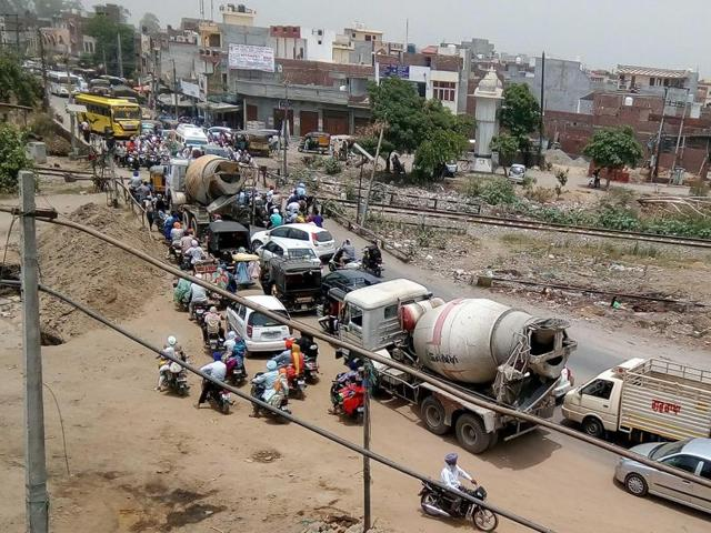 Vehicles stuck in a traffic jam near a railway crossing in Amritsar on Sunday.
