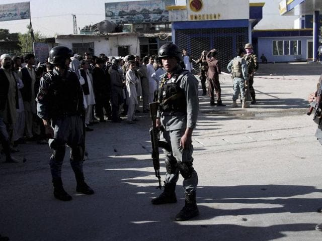 Afghan police personnel inspect the site of a suicide attack in Kabul on Monday.