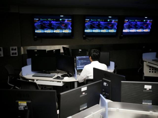 A student, who requested to be known only by surname Noh and his face not to be photographed due to security reasons, sits in front of a computer while demonstrating softwares during an interview with Reuters at War Room at The Korea University in Seoul, South Korea.