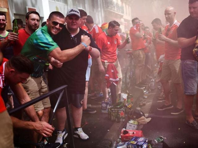 Wales' supporters cheer downtown Toulouse, southern France, on June 20, 2016 before the Euro 2016 football match of Russia vs Wales.