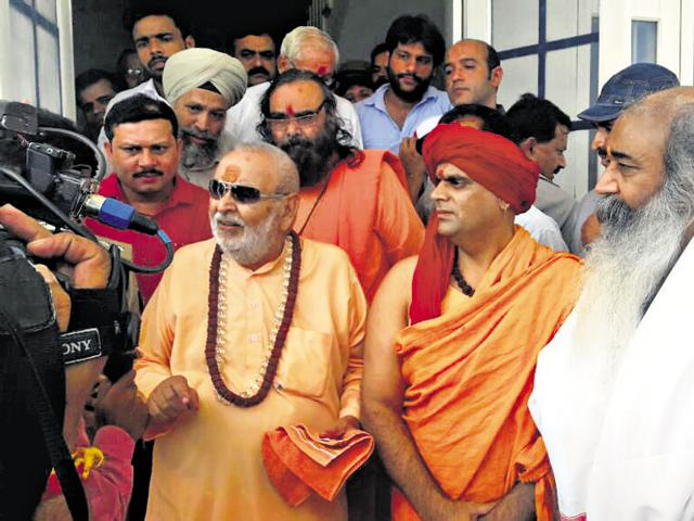 A five-member team of Hindu seers interacts with people in Kairana.