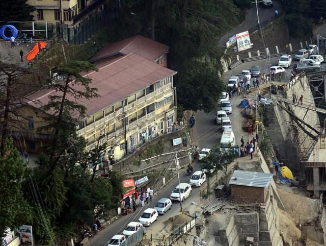 Vehicles stuck in a traffic jam near the Lift on Cart road in Shimla on Sunday.