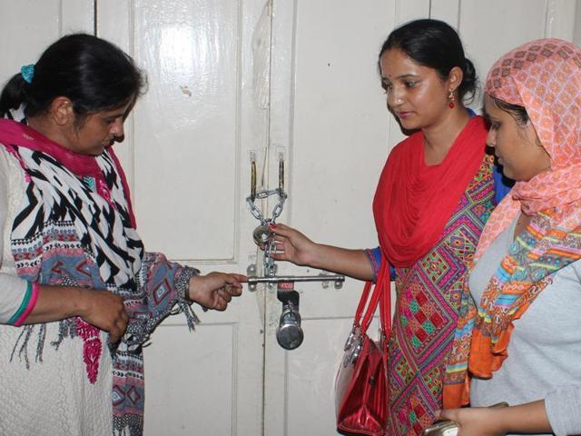 Members of the Nurses and Ancillary Staff Union locking the OPD at Rajindra Hospital in Patiala on Sunday.