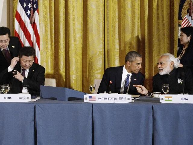 File photo of Chinese President Xi Jinping, US President Barack Obama and Indian Prime Minister Narendra Modi in Washington, DC. China is stonewalling India's membership of the Nuclear Suppliers Group though the US is supporting it.(AFP)